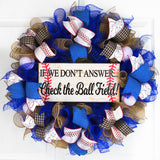 Royal Blue and Burlap wreath with baseball ribbons around the baseball sign