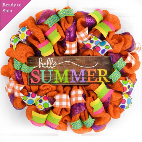 Orange burlap wreath with bright colorful ribbons surrounding the Hello Summer wooden sign
