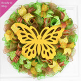 Lime green yellow and jute wreath with large yellow butterfly in the middle