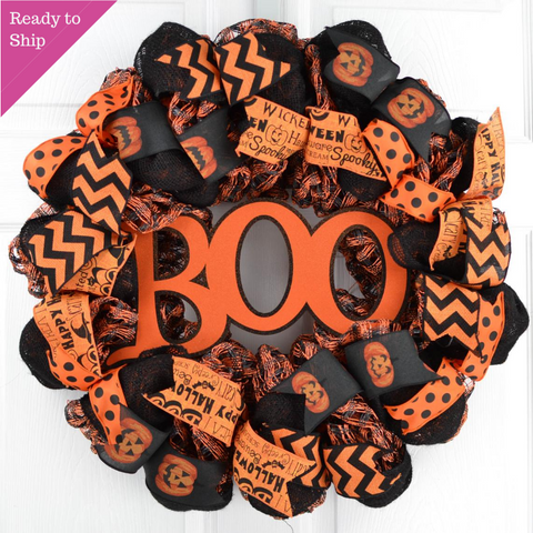 Black and orange burlap wreath with sparkly Boo in center