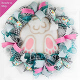 turquoise pink black and white wreath with metal bunny butt in the middle