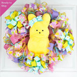 Pink and Yellow Easter wreath with Plush Yellow Bunny in middle