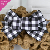 Black and white buffalo plaid bow on a burlap wreath