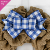 Royal Blue and white buffalo plaid bow on a burlap wreath