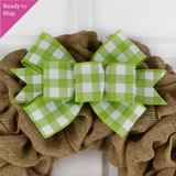 Lime Green and white buffalo plaid bow on a burlap wreath