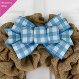 Turquoise and white buffalo plaid bow on a burlap wreath