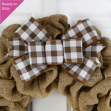 Brown and white buffalo plaid bow on a burlap wreath