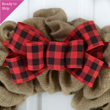 Red and black buffalo plaid bow on a burlap wreath