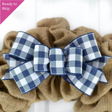 Navy Blue and white buffalo plaid bow on a burlap wreath
