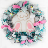 easter wreath with metal bunny butt in middle