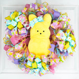Easter Wreath with plush candy bunny in middle of pink turquoise purple wreath