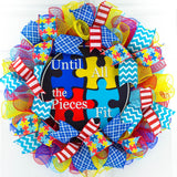 Autism wreath with Until all the Pieces fit sign in the center