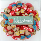 Red teacher wreath with welcome apple sign and yellow ribbons