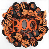Black Burlap wreath with orange ribbons and glitter Boo in center