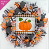 Ready to Ship black and white wreath with orange pumpkin sign in middle