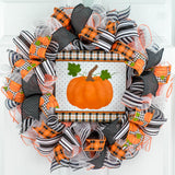 Black orange and white wreath with Halloween pumpkin sign