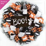 Black and white Halloween wreath with orange and black Halloween ribbons and Ghost sign