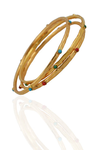 Three Gold Hammered Bangles
