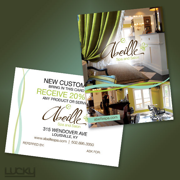 Salon and Spa Postcard. We kept this design light to match the cute and upbeat mood of their logo. A few splashes of color with the interlaced lines complete the simple, clean, and feminine look.