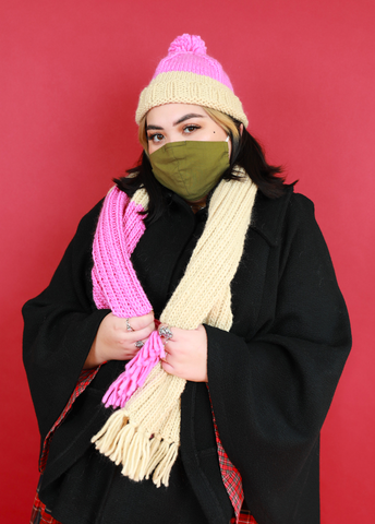 Woman holding handmade scarf using Brown Sheep Company's Lamb's Pride wool and mohair blend in Aran and RPM Pink