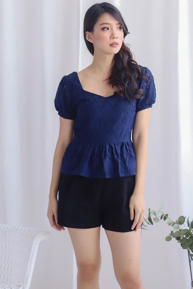 Amie Eyelet Pelum Top In Navy Blue