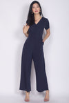 Bellarosa Sleeved Front Zip Jumpsuit In Navy Blue