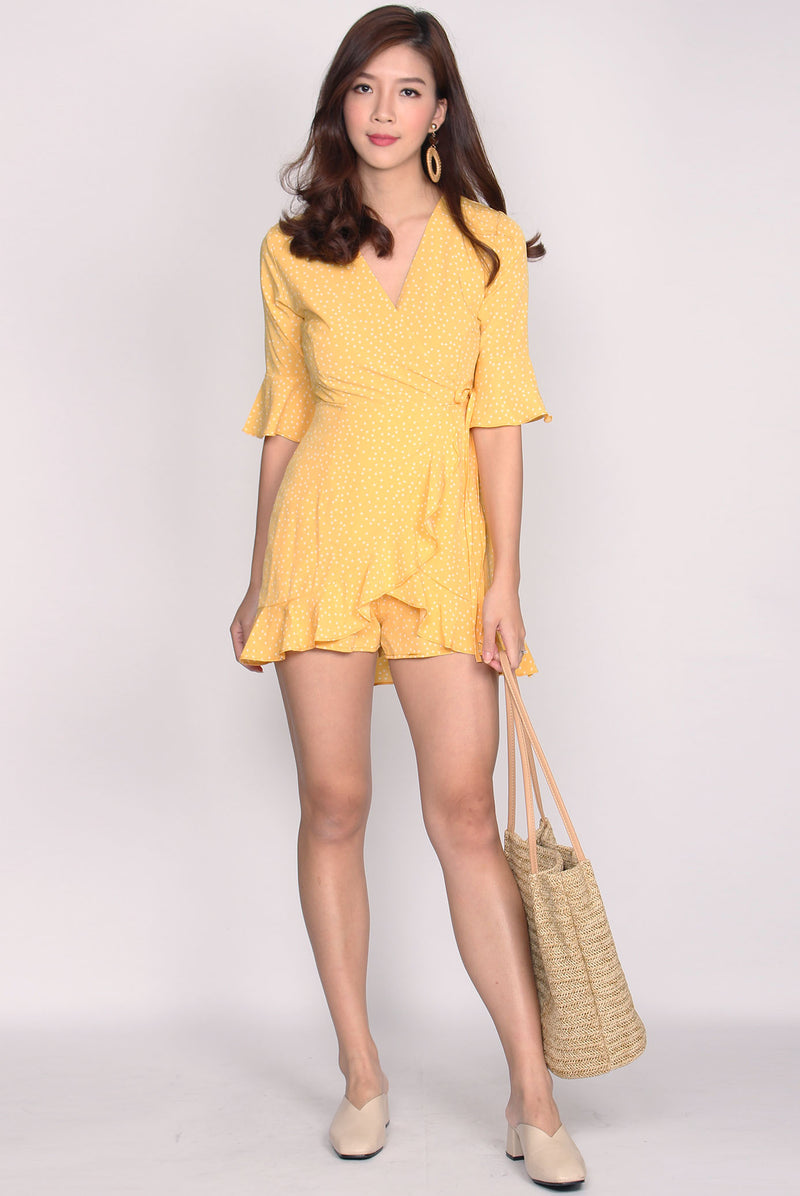 Callisto Faux Wrap Romper In Yellow