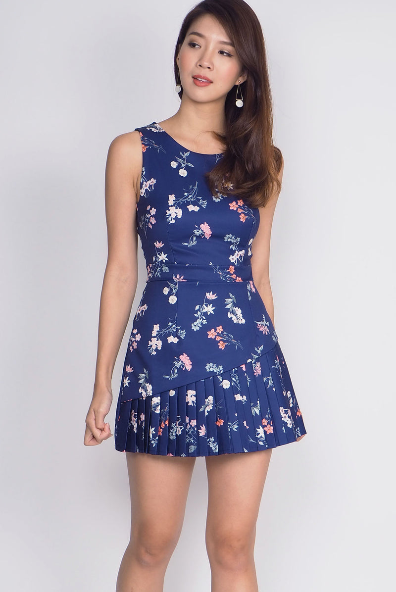 Camira Pleated Hidden Romper In Navy Floral