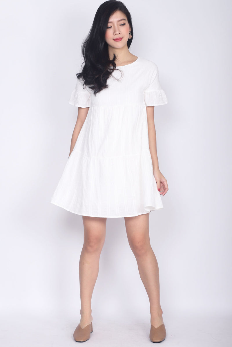 Chikako Poppy Babydoll Dress In White