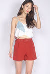 Coline Belted Shorts In Rust Red