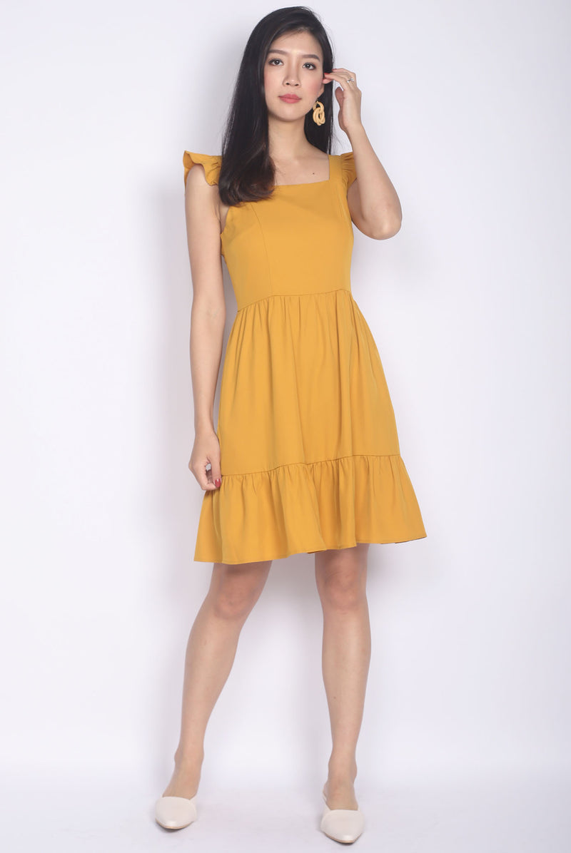 Finleigh Ruffle Strap Tiered Dress In Mustard