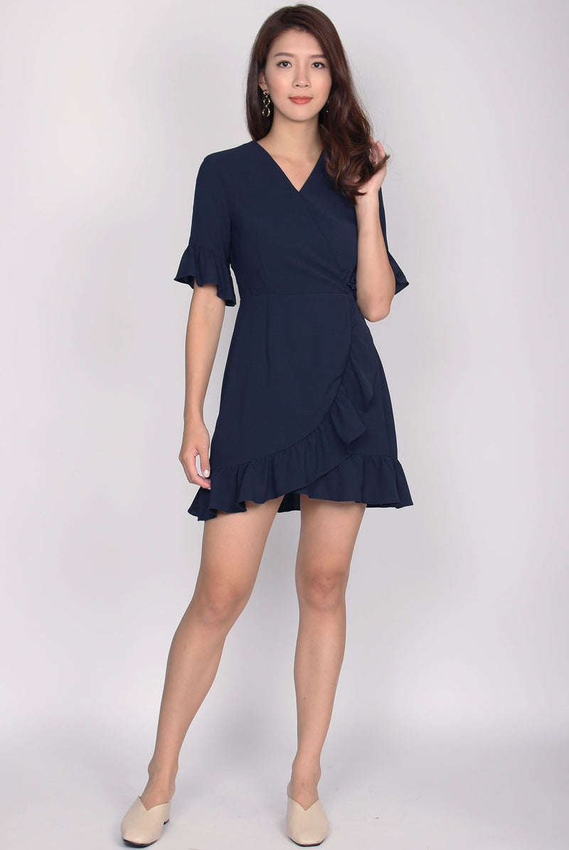 Fiorela Ruffle Faux Wrap Dress In Navy Blue
