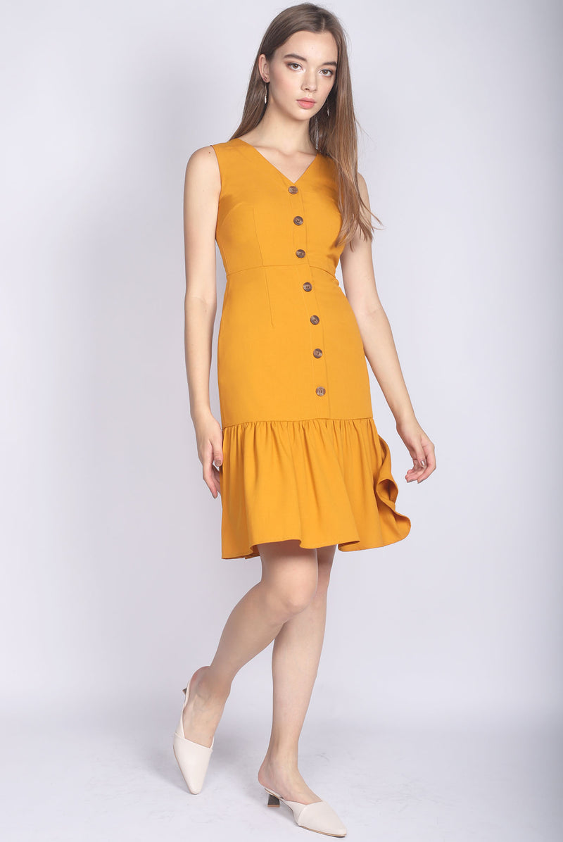 Italia Buttons Drop Hem Buttons Dress In Mustard