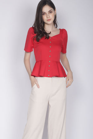 Jaslene Buttons Peplum Top In Wine Red