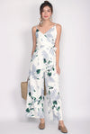 Luxia Wrap Sash Jumpsuit In White Floral