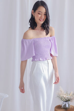 Stephi Flutter Sleeve Smocked Top In Lilac