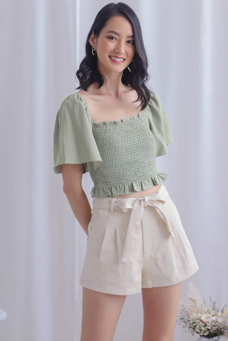 Stephi Flutter Sleeve Smocked Top In Pistachio