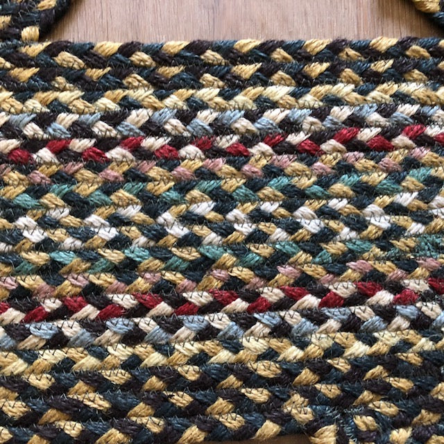 Green and Mustard Cat Braided Rug in Detail