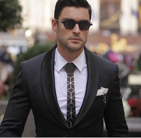 black suit with black hex tie