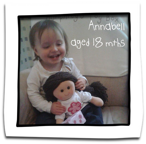 annabell with her first rag doll aged 18 months