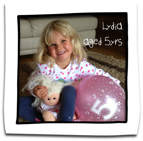 lydia aged 5 with her rag doll
