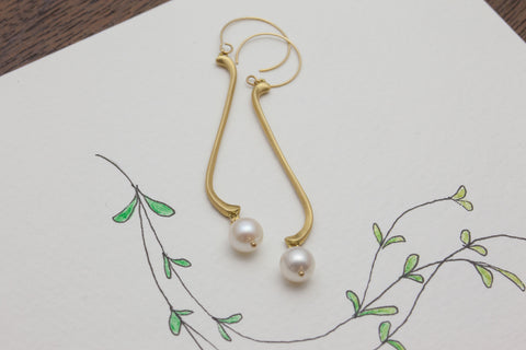 AMousse large single flute earring with Akoya pearls
