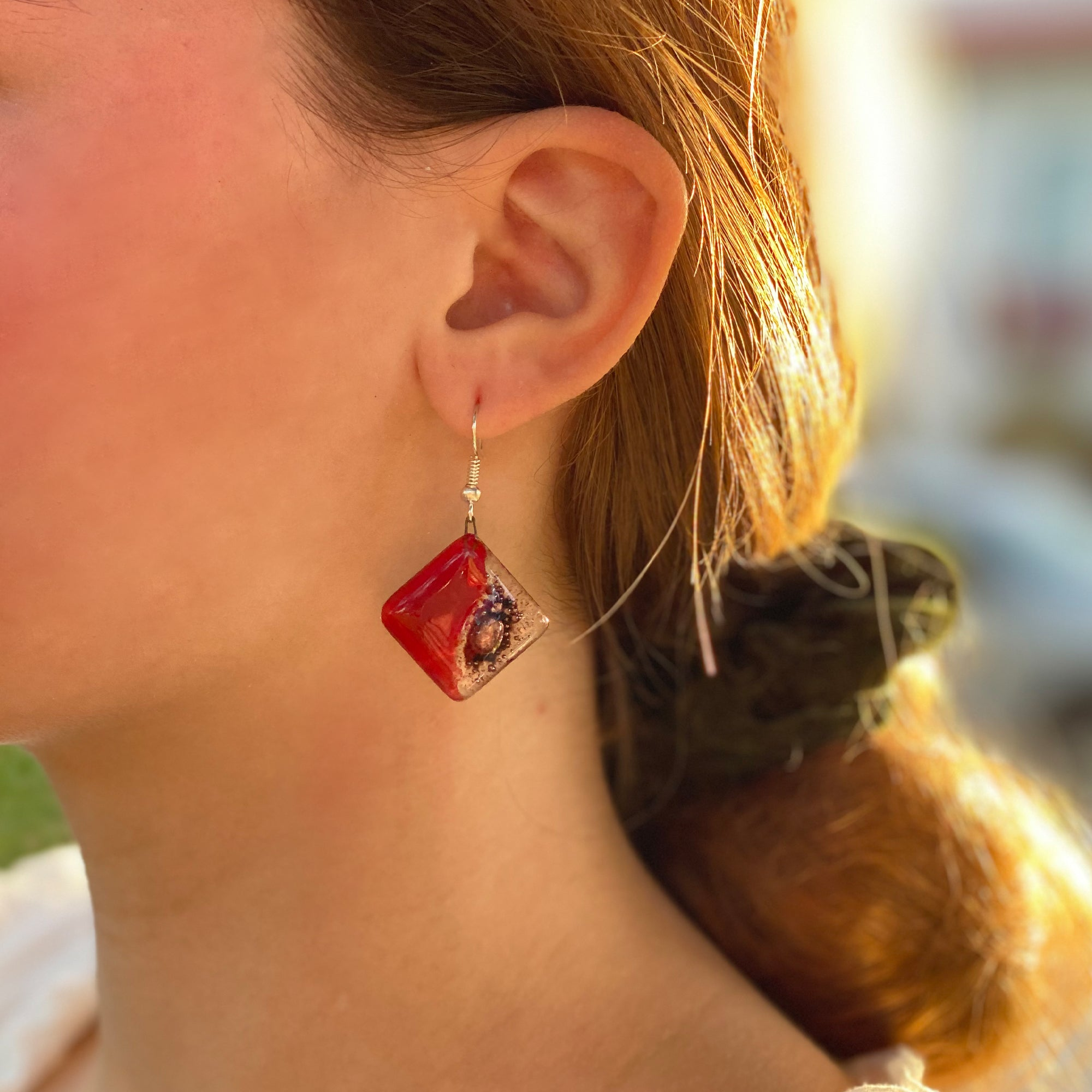 Handmade square glass dangle earrings from Fair Trade group in Chile