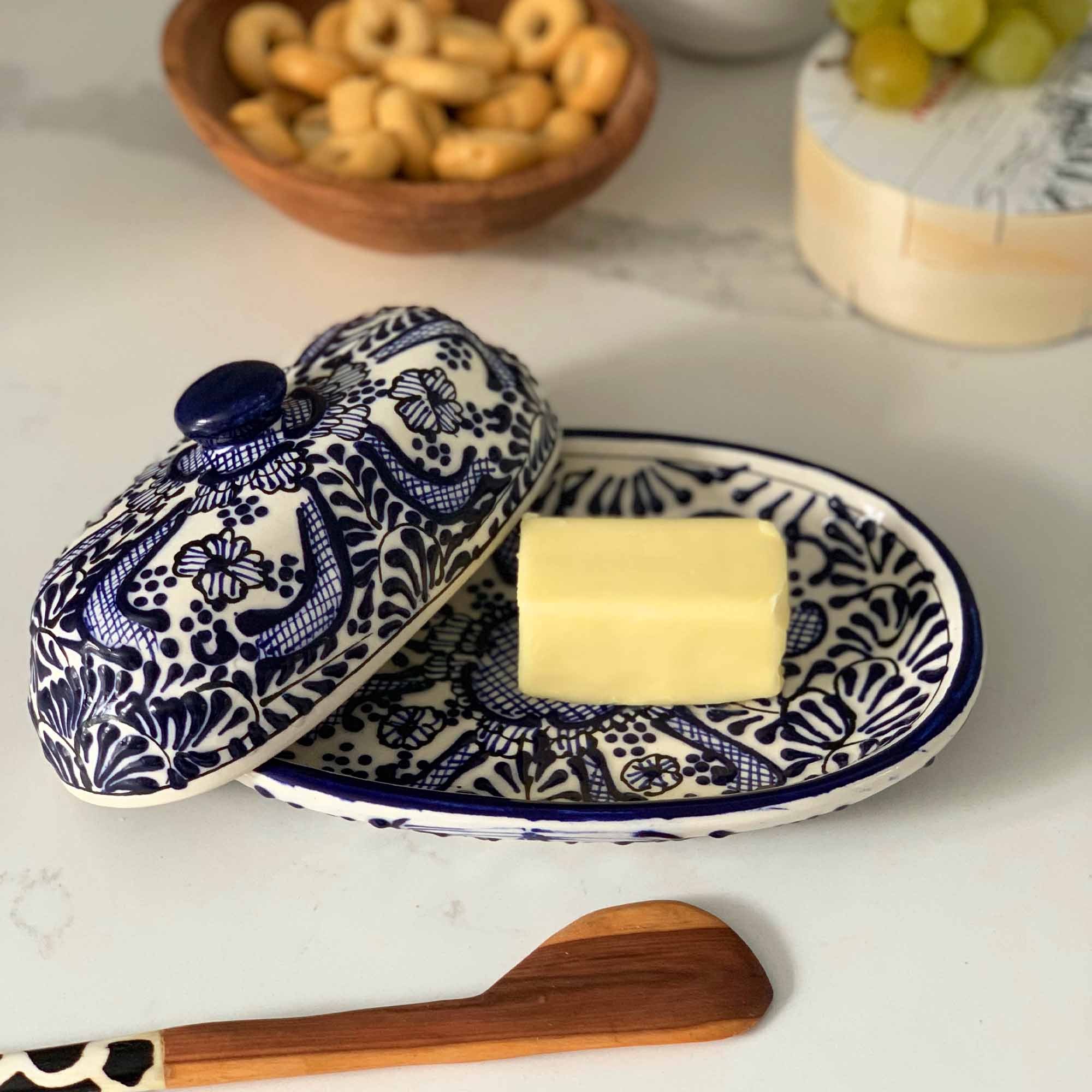 Authentic Mexican Pottery butter dish in blue and white flower design with hand-carved wood serving piece from Kenya.