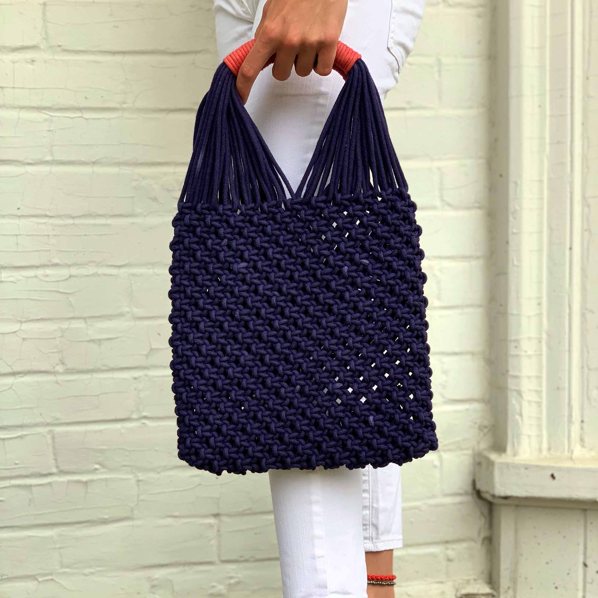 Dark blue macrame hand bag with coral handle