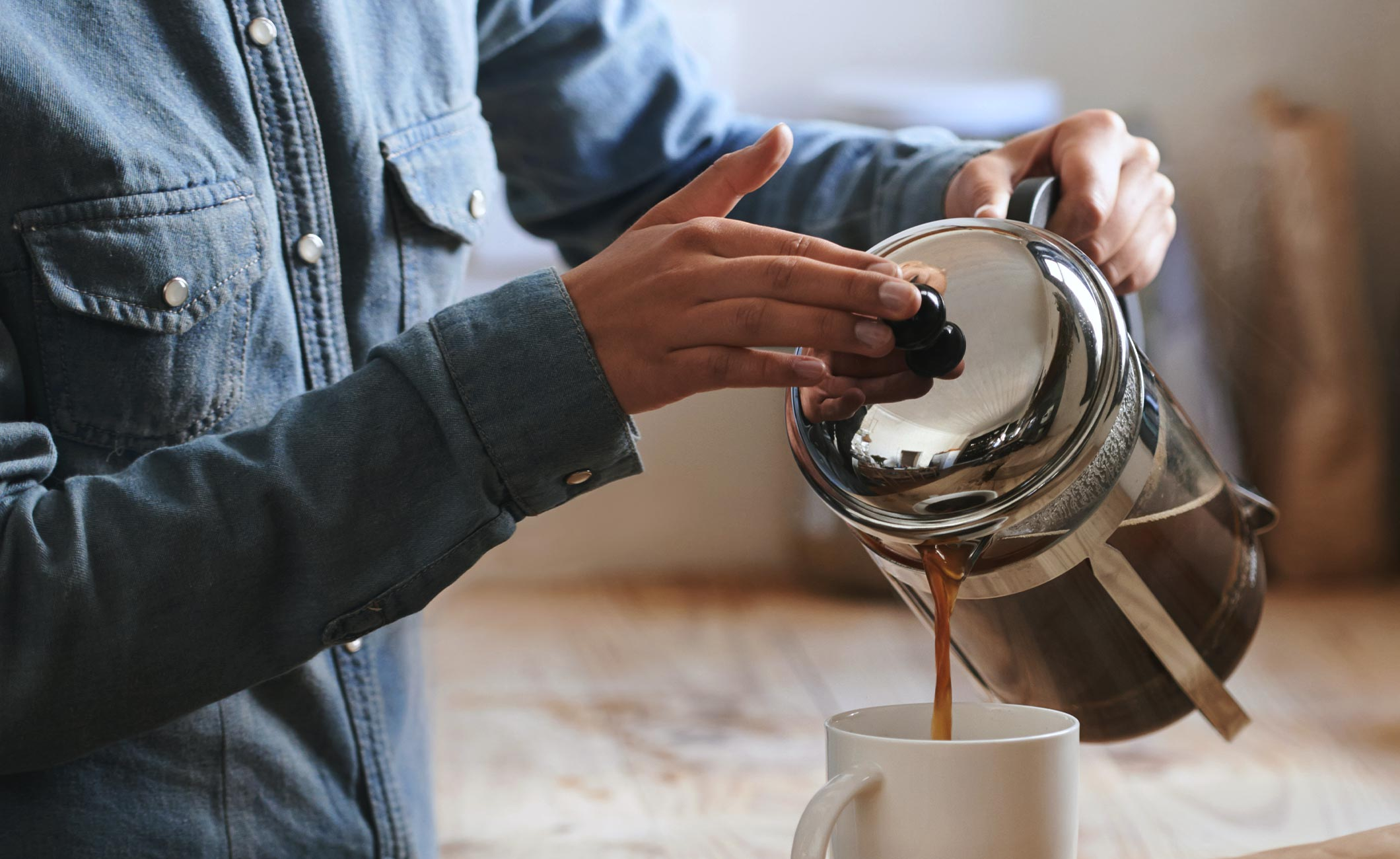 someone pouring a cup of coffee