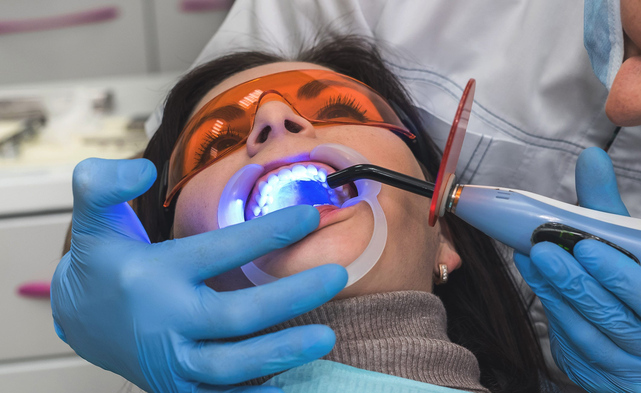 laser teeth whitening being done on a woman