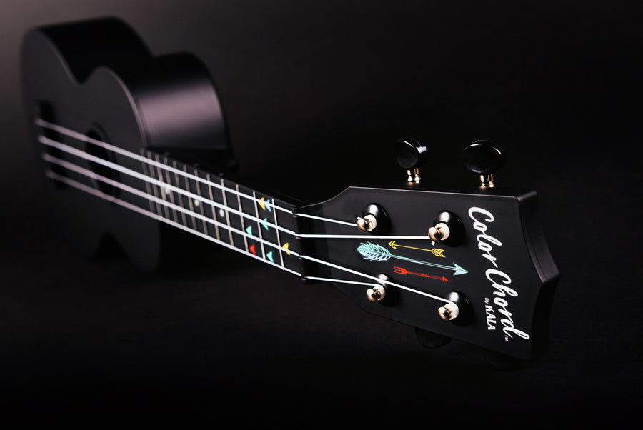 Kala Color Chord™ Ukulele long profile image with headstock with logo, tuners, strings, fretboard, and color-coded chord markers.