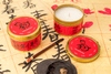 Chinese New Year fair trade soy blend candle and paintbrush, year of the dog, handmade by women refugee artisans at Prosperity Candle in the United States.