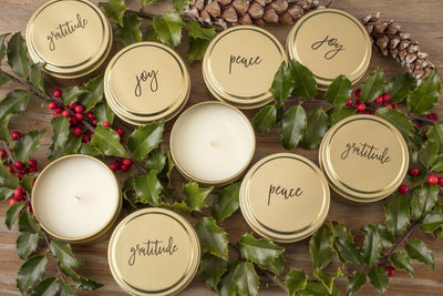 Peace, Joy and gratitude gold soy blend  wholesale candles handmade by women artisans in the United States. Best holiday gift that gives back. Gold travel tin candles add beauty to the home.